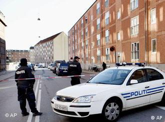 Danish police in front of apartment building