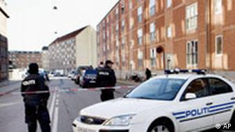 Danish police close off the street in the North West area of Copenhagen where Danish police intelligence services arrested a taxi driver suspected of preparing an act of terrorism in 2007