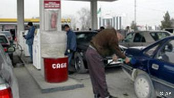Motorists refuel their cars at a gas station in Ashgabat, Turkmenistan, Saturday, Feb. 9, 2008.