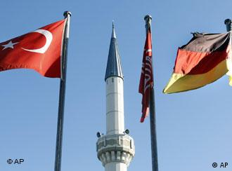 A German and Turkish flag in front of a mosque