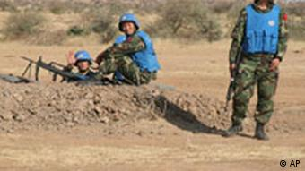 Chinese UN peacekeepers guard engineers building on a new UN base in Darfur, Sudan