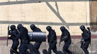 Kosovs riot police members during training