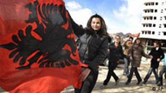 Students dance with the Albanian flag while celebrating the anticipated upcoming independence of Kosovo