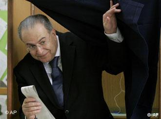 Former Foreign Minister Ioannis Kasoulides exits the booth after casting his vote
