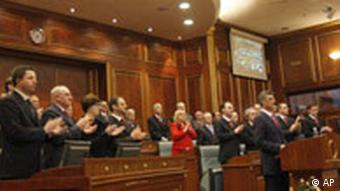 Kosovo's Prime Minister Hashim Thaci addresses the members of the Parliament as the members of his government applaud during a special session of the Parliament in Pristina