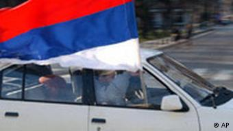 Bosnian Serb youth members of the Serb Public League drive a car and wave a Serbian flag during a protest against Kosovo's declaration of independence, at the main square, in the Bosnian town of the Banja Luka