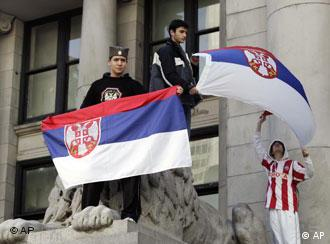 Serbian supporters fly flags in a protest against Kosovo's independence