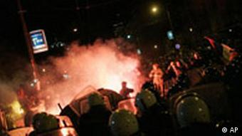 Serbian riot police clash with protesters in front of the US Embassy in Belgrade, Serbia