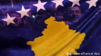 Kosovo Albanians celebrate with the new Kosovo flag the independence in Kosovo's capital Pristina on February 17, 2008