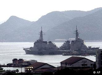 Japanese Maritime Self-Defense Force's Aegis-class destroyer Kongo, left, and another vessel are anchored at Sasebo naval base, Japan, Wednesday, Sept. 26, 2001. Legislation authorizing Japan's military to support the U.S.-led war on terror won final approval Monday, Oct. 29, 2001, paving the way for Japan to send non-combat troops overseas. The Sasebo base in southern Japan has become the likely launching point for whatever Japan's first step might be.