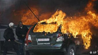 Burning vehicle after clashes in Kosovo