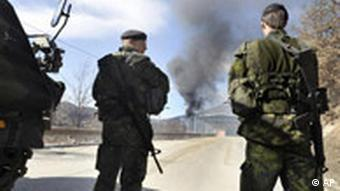 UN special police forces check a burning border station