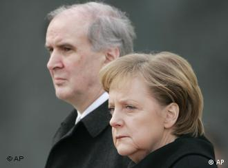 Merkel and Hasler wearing stren expressions