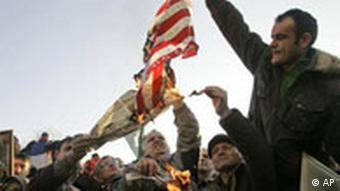 Protesters set an American flag on fire during protests in Belgrade