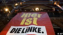 Anhaenger der Partei die Die Linke, warten am Sonntag, 24. Februar 2008, bei der Wahlparty der Partei auf die Prognose.(AP Photo/Joerg Sarbach) ---Supporters of theLeft Party await the prognosis at the election party in Hamburg, northern Germany, on Sunday, Feb. 24, 2008. Banner reads Here is the Left(AP Photo/Joerg Sarbach)