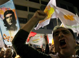 Supporters of Communist President-elect Dimitris Christofias wave Cyprus and Che Guevara flags during victory celebrations