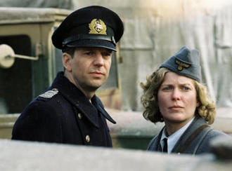 An actor and actress in uniform