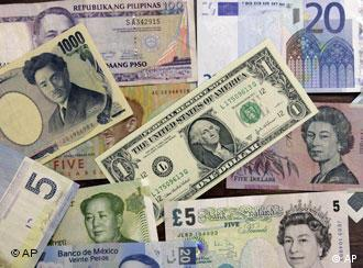 A US one dollar note is seen among other foreign currencies