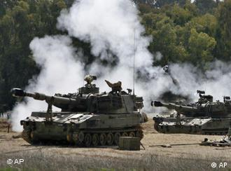 Israeli tanks with smoke coming out of their turrets