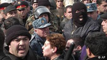 Opposition supporters clash with police during a protest in Yerevan, Armenia, Saturday, March 1, 2008.