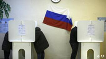 Russians vote in a polling station in Moscow