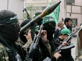 Masked Hamas militants hold weapons during a protest against Israel's attacks on the Gaza Strip Photo: AP