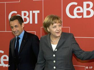 French President Nicolas Sarkozy with German Chancellor Angela Merkel