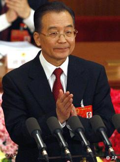 Chinese Premier, Wen Jiabao, applauds as he addresses the opening session of the National People's Congress held at the Great Hall of the People in Beijing, Wednesday, March 5, 2008. China's premier called Wednesday for powerful measures to rein in inflation that is battering ordinary Chinese and warned of risks from a global slowdown and the U.S. credit crisis. (AP Photo/Ng Han Guan)
