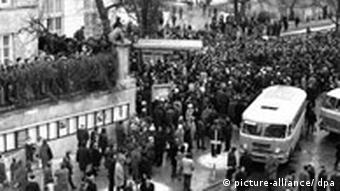 Historical photograph of a student protest march in Warsaw on March 8, 1968