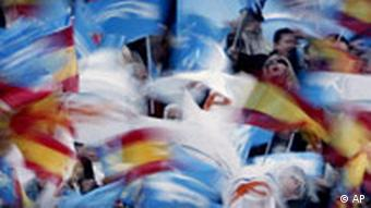 Conservative supporters wave Spanish and party flags