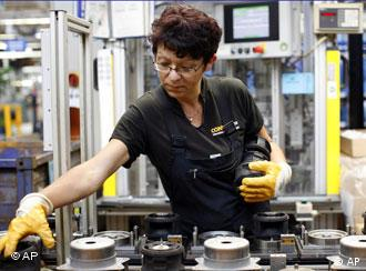 A woman working at a plant manufacturing of hydraulic jacks
