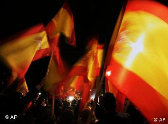 People wave Spanish flags during a protest against the Basque separatist group ETA in Madrid