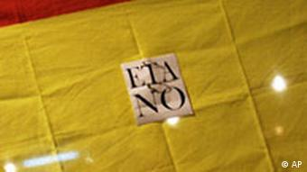 A man is seen in front of a Spanish flag during a protest against the Basque separatist group ETA