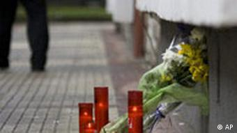 Flowers and candles are seen near the site where slain Basque politician Isaias Carrasco was killed