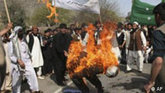 Afghan students burn an effigy during a demonstration against the reproduction of cartoons depicting the Prophet Muhammad in Danish newspapers and the Wilders film