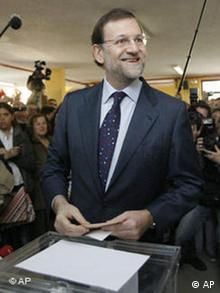 People's Party candidate Mariano Rajoy casts his vote