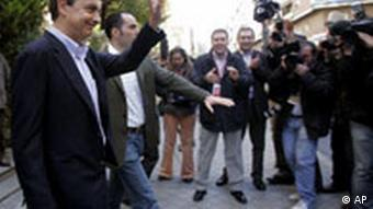 Zapatero waves after casting his ballot
