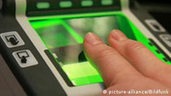 A fingerprint reader scans a person's fingers