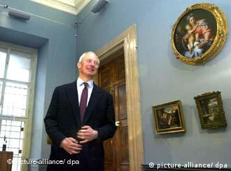 Liechtenstein's Prince Adam II stands in front of paintings on display at the Liechtenstein Museum in Vienna