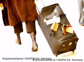 A woman pulling a suitcase