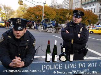 New York policemen pose with bottles of German wine