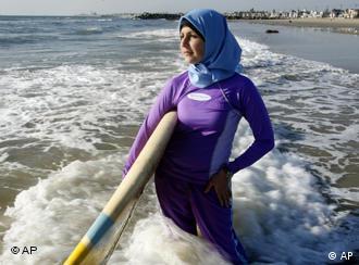 A Muslim woman covered head to toe in swimwear and headscarf