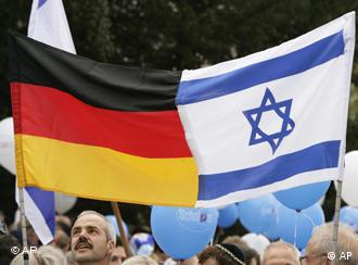 People hold Israeli and German flags