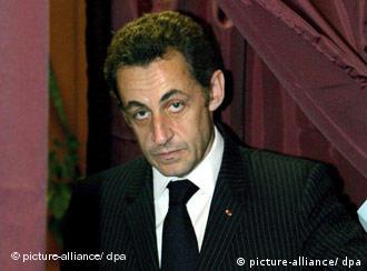 Sarkozy leaves the voting booth on his way to cast his ballot at a polling station in Paris