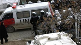 Members of the special UN police unit protect the UN court compound