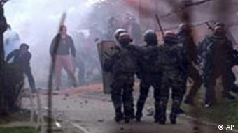 Serb protesters throw stones and other missiles at French NATO peacekeeping troops
