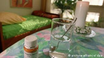 A bedroom at Swiss assisted suicide clinic Dignitas, with suicide medication on the table