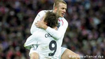 England's Peter Crouch celebrates a goal with David Beckham