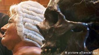 A mold of Johann Sebastian Bach's skull next to a reconstruction of his head at an exhibition (c)