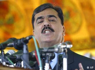 Pakistani Prime Minister Yousuf Raza Gilani was not in the motorcade as gunmen shot at his car on Wednesday